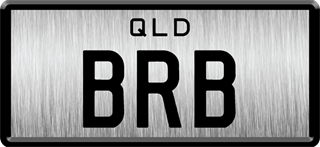 Framed ID plate with black writing on a brushed metal background. The combination reads B R B.