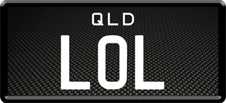 Framed ID plate with white writing on a brushed carbon fibre background. The combination reads L O L.