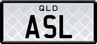 Framed ID plate with black writing on a checkerplate background. The combination reads A S L.