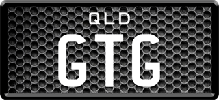 Framed ID plate with white writing on a metal grill background. The combination reads G T G.