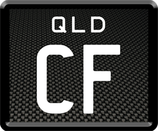 Framed ID plate with white writing on a carbon fibre background. The combination reads C F.