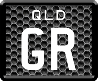 Framed ID plate with white writing on a metal grill background. The combination reads G R.