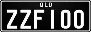 Monochrome plate with white writing on a black background. The combination reads Z Z F 1 0 0.