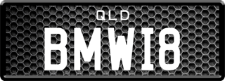 Framed Prestige plate with white writing on a metal grill background. The combination reads B M W 1 8.