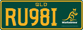 Wallabies Team plate with gold writing on a dark green background. The combination reads R U 9 8 I with the team logo to the right of the combination.