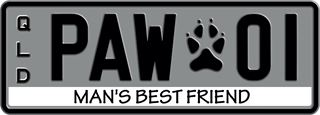Man's Best Friend theme plate with black writing on a grey background. The combination reads P A W 0 1. A paw print separates and W and the 0. The words 'Man's Best Friend' are beneath the combination.