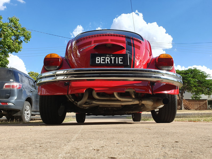 Bertie the bright red Beetle showing off B E R T 1 E personalised plates